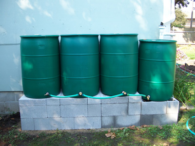 Connect Rain Barrels With Concrete Block Stand